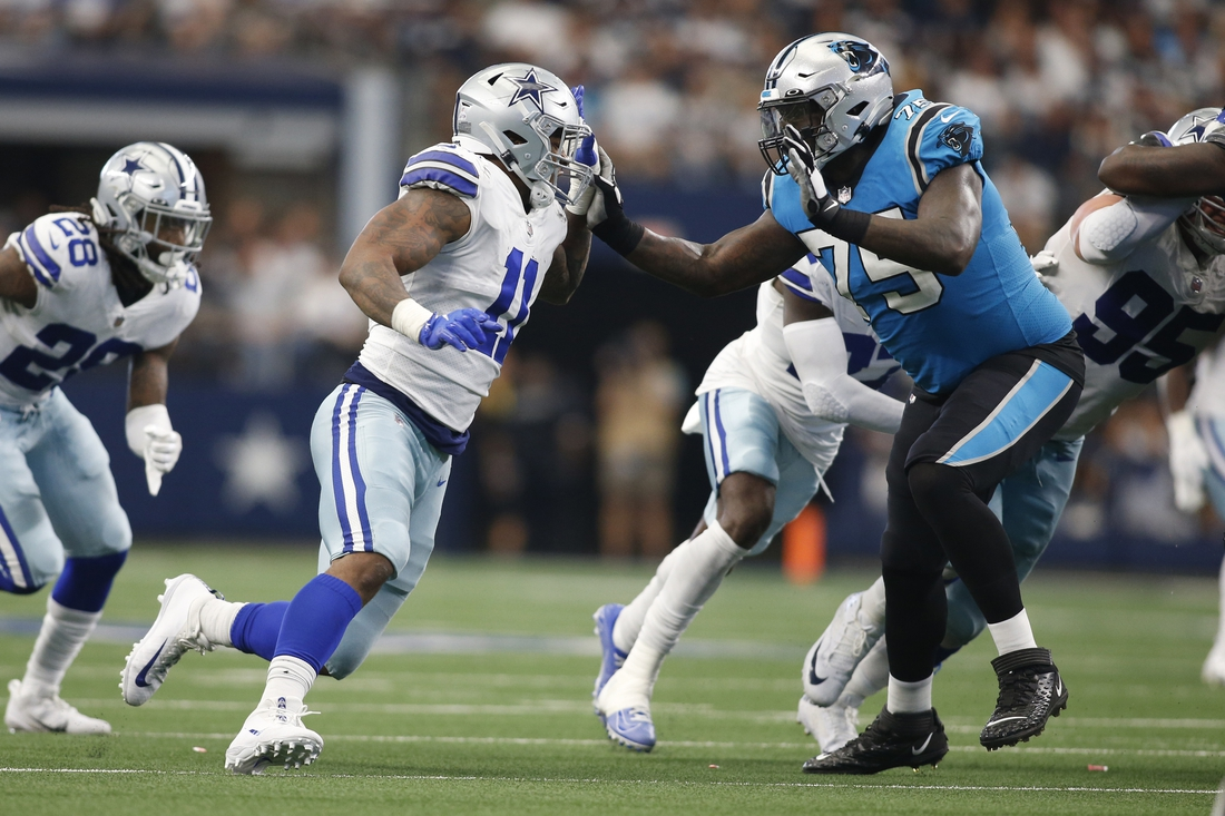 Oct 3, 2021; Arlington, Texas, USA; Dallas Cowboys linebacker Micah Parsons (11) rushes against Carolina Panthers offensive tackle Cameron Erving (75) in the fourth quarter at AT&T Stadium. Mandatory Credit: Tim Heitman-USA TODAY Sports