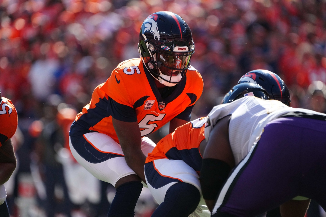 Oct 3, 2021; Denver, Colorado, USA; Denver Broncos quarterback Teddy Bridgewater (5) during the first quarter against the Baltimore Ravens at Empower Field at Mile High. Mandatory Credit: Ron Chenoy-USA TODAY Sports
