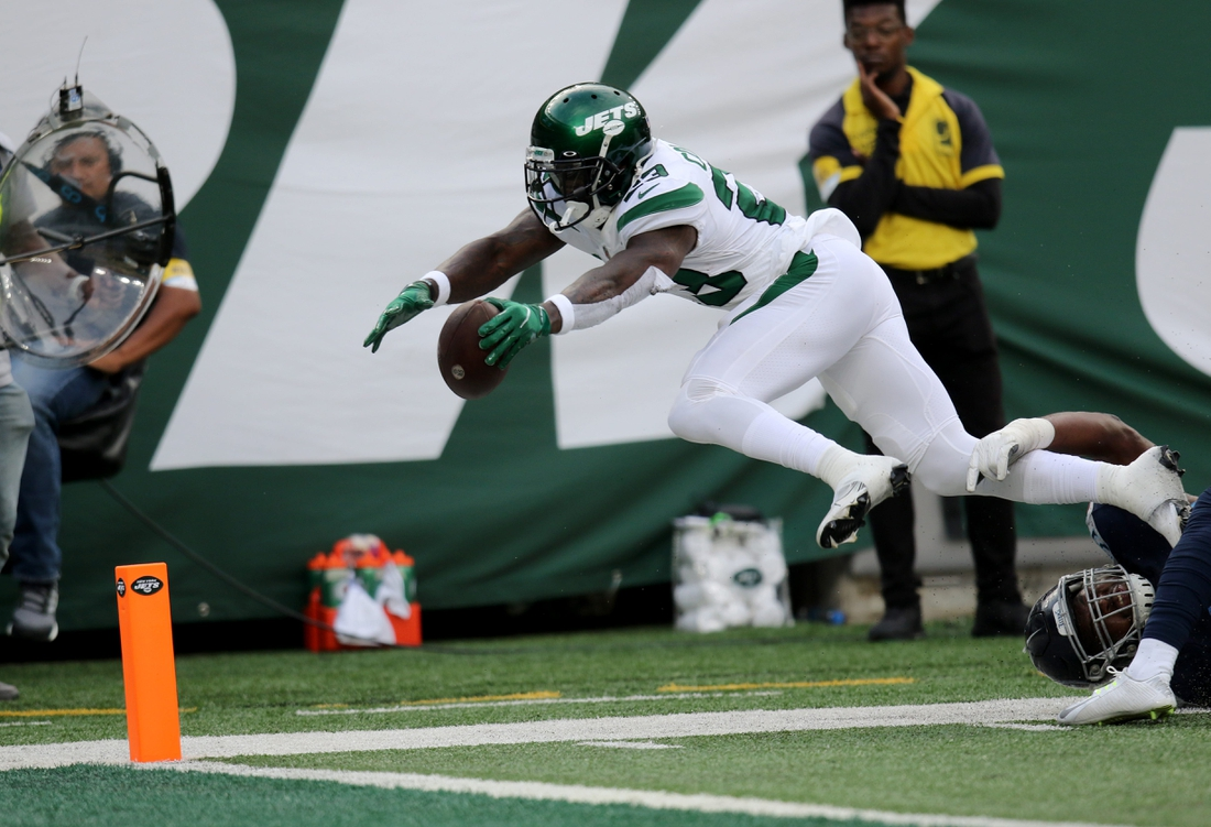Tevin Coleman, of the New York Jets, leaps towards the end zone in overtime.  It was ruled that Coleman was a a little short of the end zone and the Jets ended up with a field goal which was enough the beat the Titans, 27-24. Sunday, October 3, 2021  Nfl Week 4 Jets V Titans