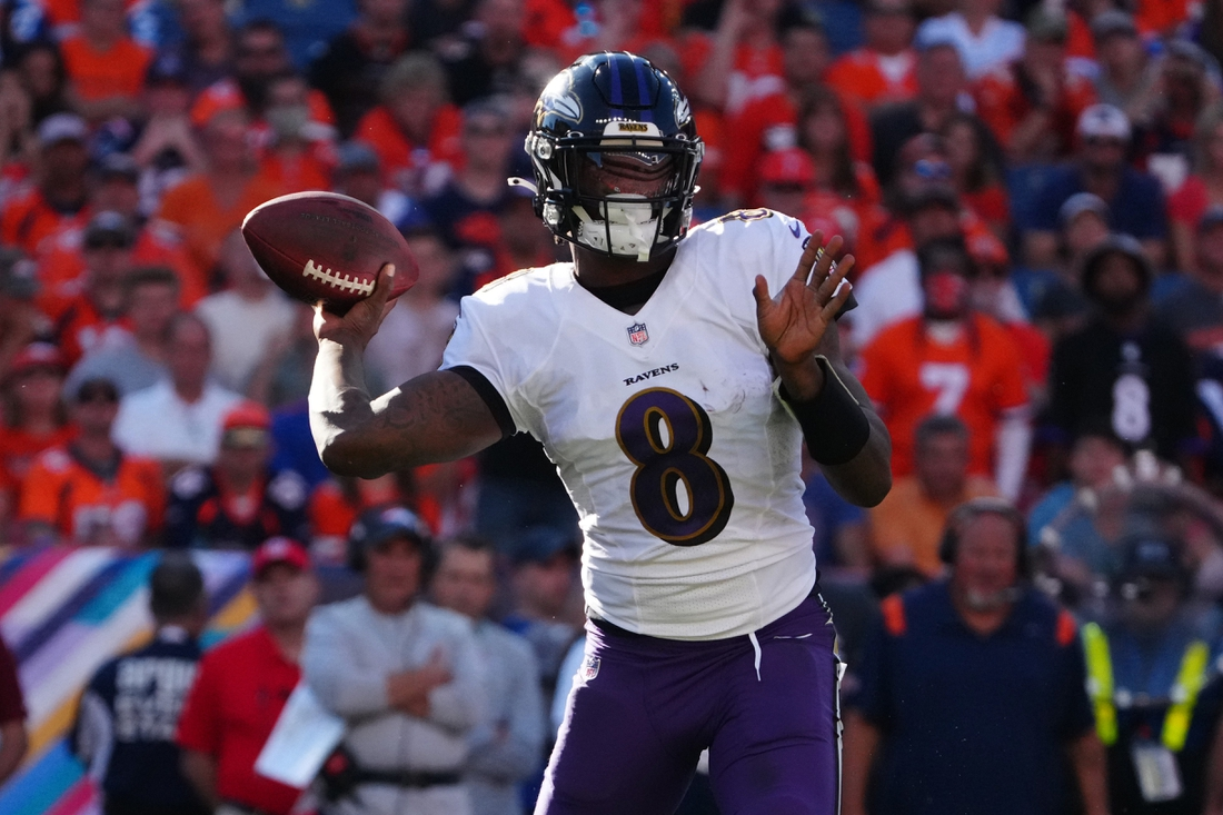 Oct 3, 2021; Denver, Colorado, USA; Baltimore Ravens quarterback Lamar Jackson (8) prepares to pass the ball in the third quarter against the Denver Broncos at Empower Field at Mile High. Mandatory Credit: Ron Chenoy-USA TODAY Sports