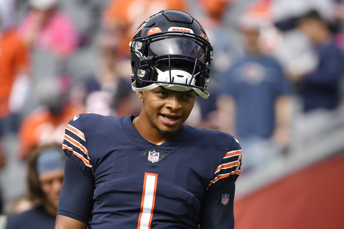 Oct 3, 2021; Chicago, Illinois, USA; Chicago Bears quarterback Justin Fields (1) looks on before the game against the Detroit Lions at Soldier Field. Mandatory Credit: Quinn Harris-USA TODAY Sports