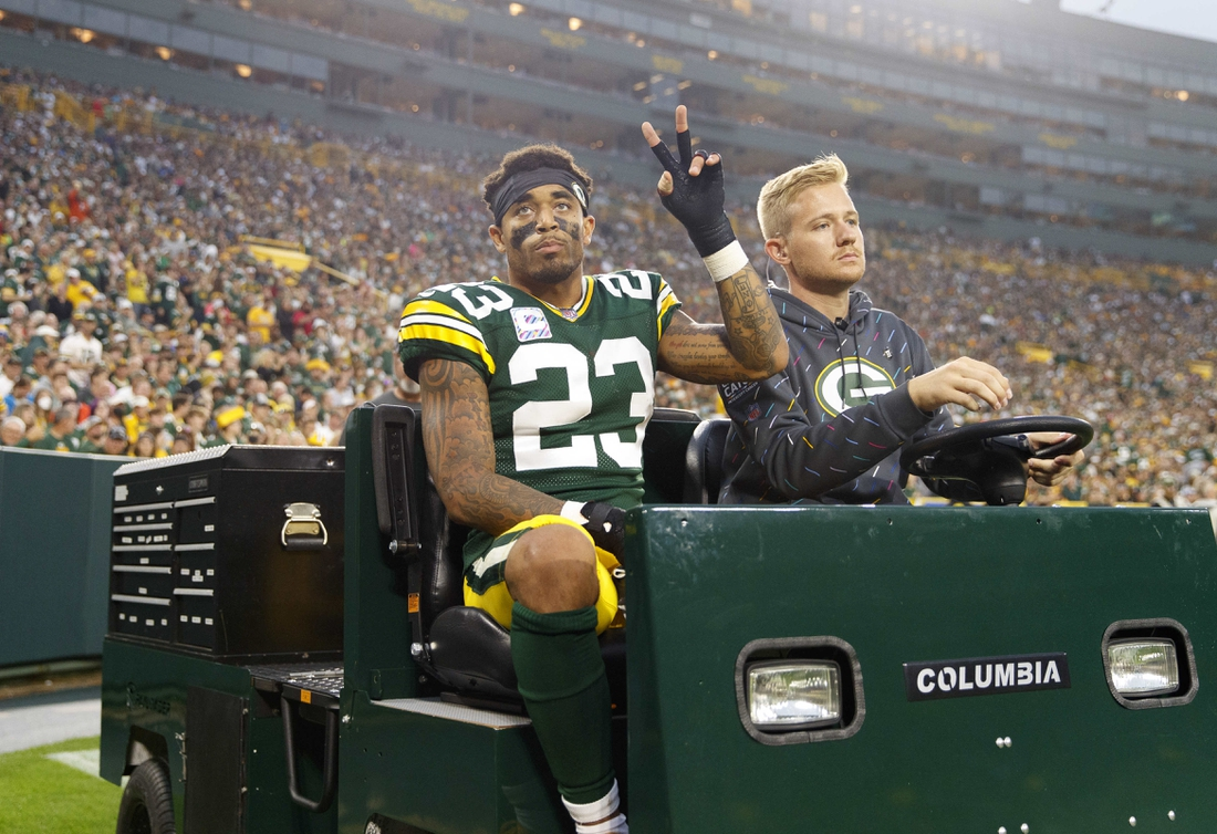 Oct 3, 2021; Green Bay, Wisconsin, USA;  Green Bay Packers cornerback Jaire Alexander (23) is driven from the field after being injured during the third quarter against the Pittsburgh Steelers at Lambeau Field. Mandatory Credit: Jeff Hanisch-USA TODAY Sports