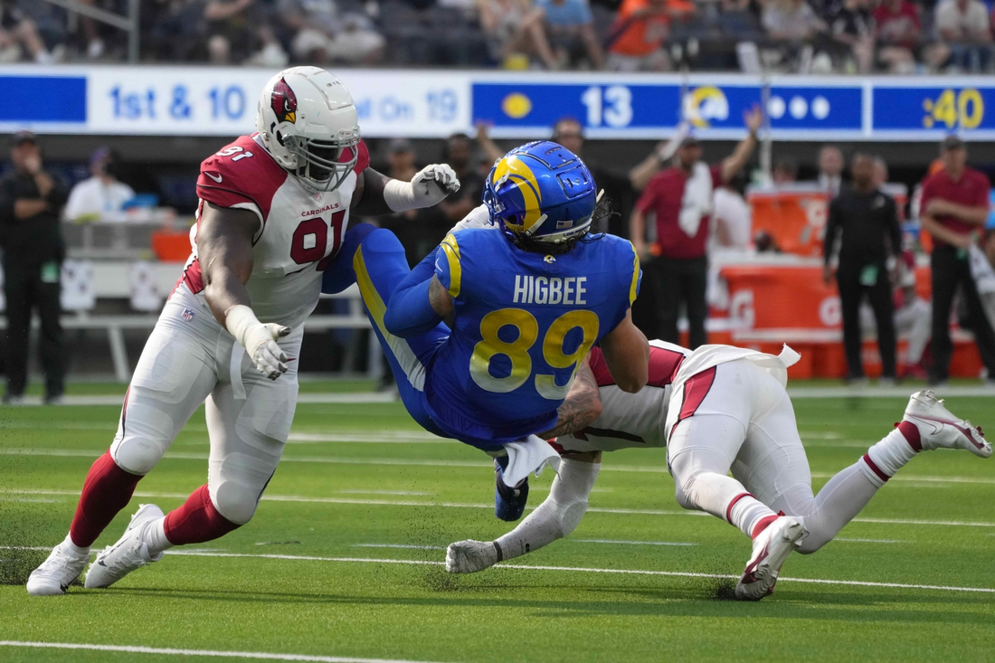 Oct 3, 2021; Inglewood, California, USA; Los Angeles Rams tight end Tyler Higbee (89) is tackled by Arizona Cardinals defensive end Michael Dogbe (91) and cornerback Byron Murphy (7) in the second half at SoFi Stadium. The Cardinals defeated the Rams 37-20. Mandatory Credit: Kirby Lee-USA TODAY Sports