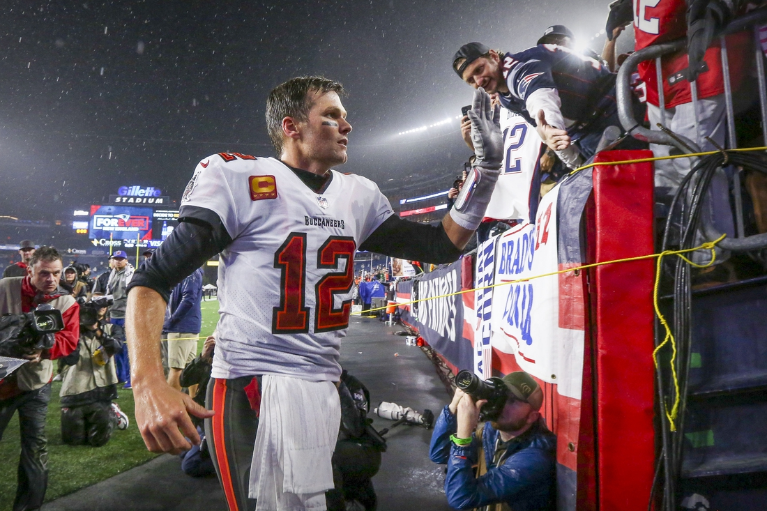 Oct 3, 2021; Foxboro, MA, USA; Tampa Bay Buccaneers quarterback Tom Brady (12) runs off the field after the win over the New England Patriots at Gillette Stadium.  Mandatory Credit: Paul Rutherford-USA TODAY Sports