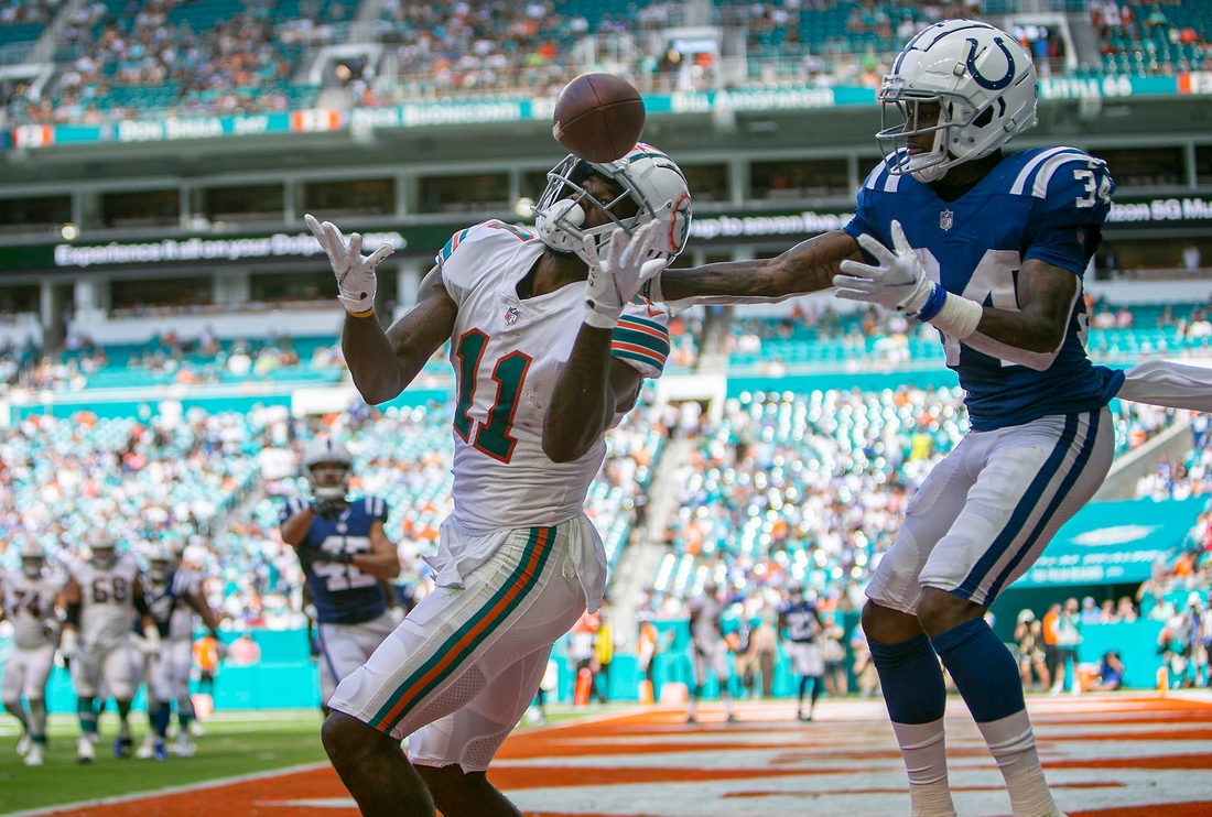 Miami Dolphins Miami Dolphins wide receiver DeVante Parker (11), can't come down with the ball in the end zone against Indianapolis Colts Indianapolis Colts cornerback Isaiah Rodgers (34), during NFL game at Hard Rock Stadium Sunday in Miami Gardens.