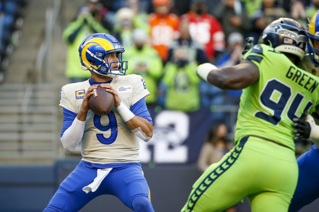Oct 7, 2021; Seattle, Washington, USA; Los Angeles Rams quarterback Matthew Stafford (9) looks to pass against the Seattle Seahawks during the first quarter at Lumen Field. Mandatory Credit: Joe Nicholson-USA TODAY Sports