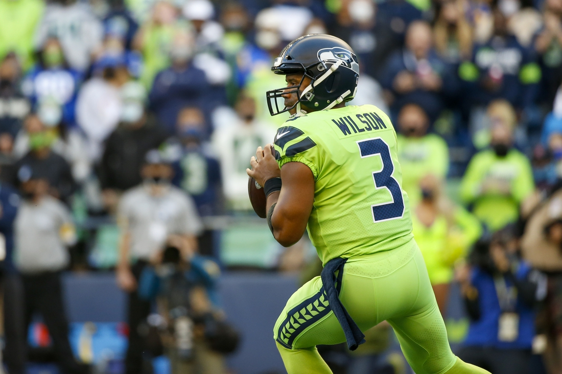 Oct 7, 2021; Seattle, Washington, USA; Seattle Seahawks quarterback Russell Wilson (3) looks to pass against the Los Angeles Rams during the first quarter at Lumen Field. Mandatory Credit: Joe Nicholson-USA TODAY Sports