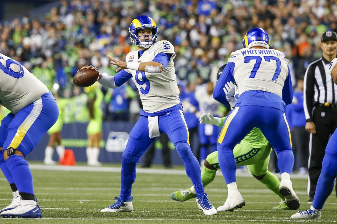 Oct 7, 2021; Seattle, Washington, USA; Los Angeles Rams quarterback Matthew Stafford (9) throws a pass against the Seattle Seahawks during the fourth quarter at Lumen Field. Mandatory Credit: Joe Nicholson-USA TODAY Sports
