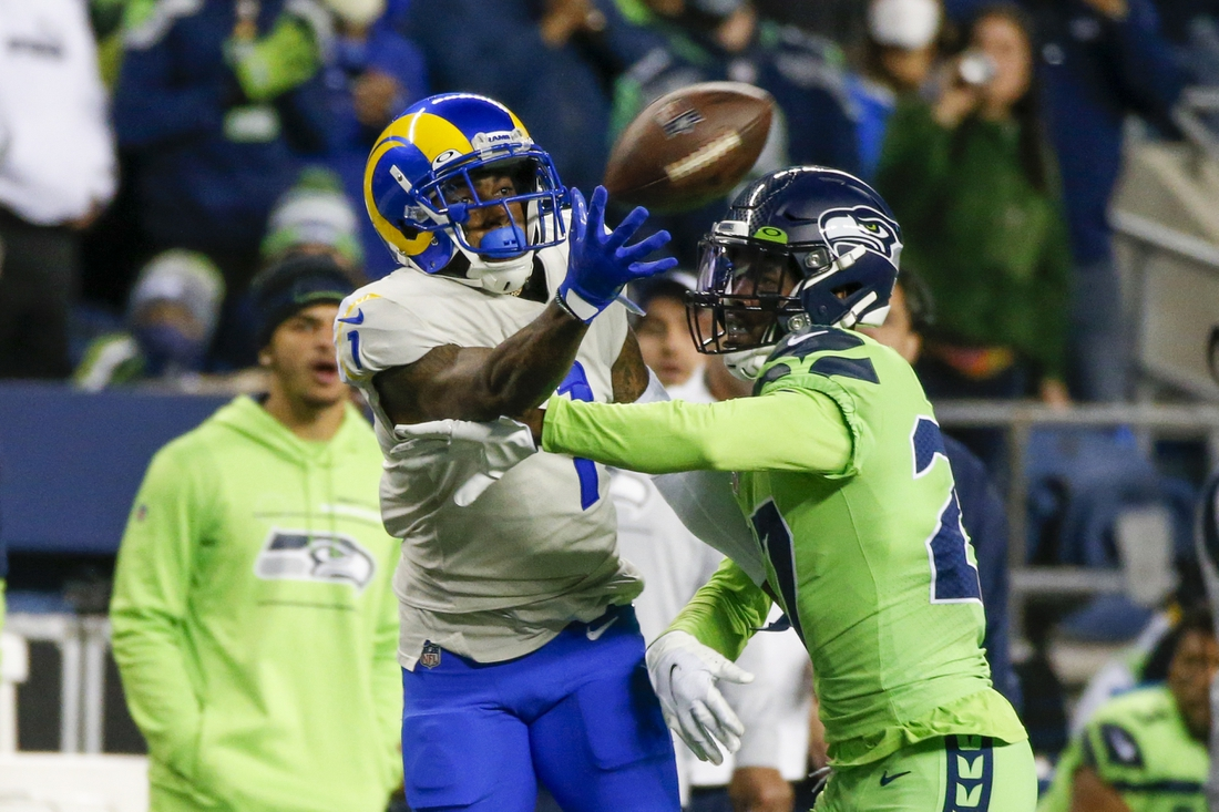 Oct 7, 2021; Seattle, Washington, USA; Seattle Seahawks defensive back Marquise Blair (27) breaks up a pass intended for Los Angeles Rams wide receiver DeSean Jackson (1) during the fourth quarter at Lumen Field. Mandatory Credit: Joe Nicholson-USA TODAY Sports