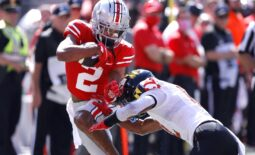 Oct 9, 2021; Columbus, Ohio, USA; Ohio State Buckeyes wide receiver Chris Olave (2) is tackled by Maryland Terrapins defensive back Tarheeb Still (12)during the first quarter at Ohio Stadium. Mandatory Credit: Joseph Maiorana-USA TODAY Sports
