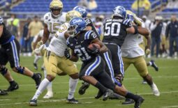 Oct 9, 2021; Durham, North Carolina, Duke Blue Devils running back Mataeo Durant (21) runs the ball against the Georgia Tech Yellow Jackets during the first quarter at Wallace Wade Stadium. Mandatory Credit: William Howard-USA TODAY Sports.