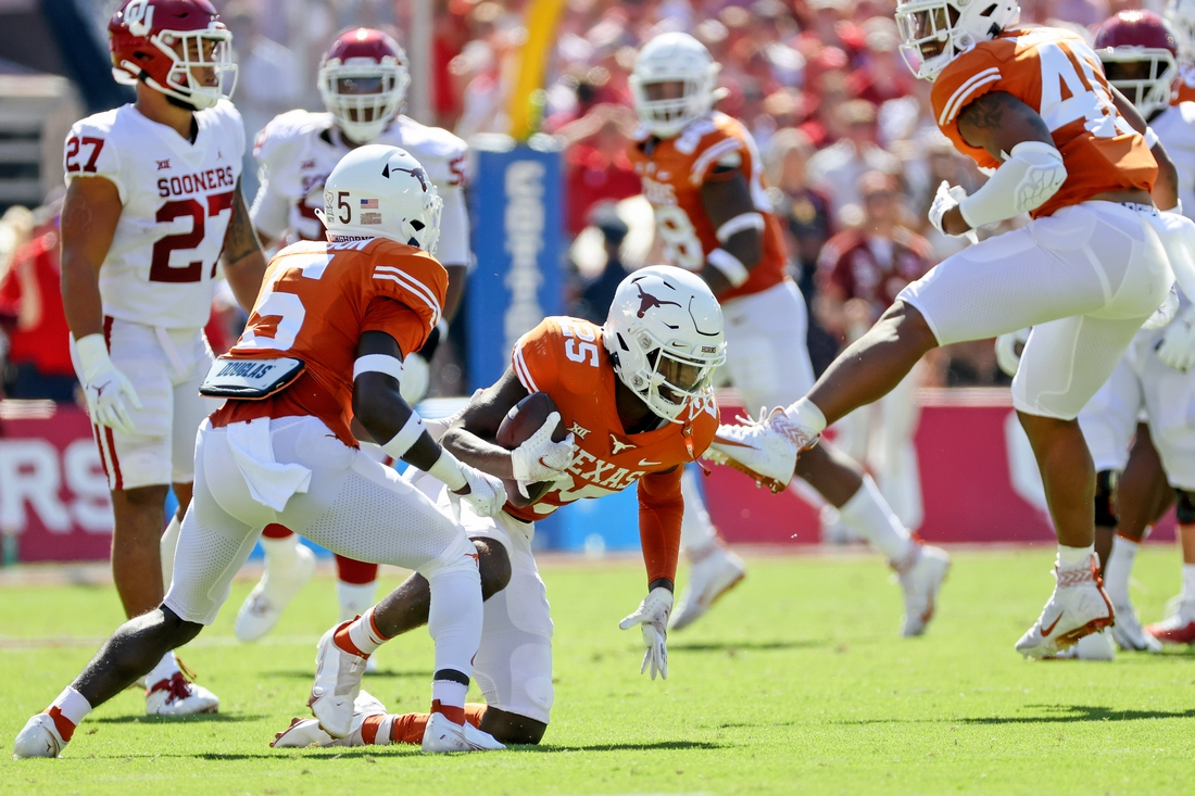 Oct 9, 2021; Dallas, Texas, USA; Texas Longhorns defensive back B.J. Foster (25) reacts after intercepting a pass against the Oklahoma Sooners during the first quarter at the Cotton Bowl. Mandatory Credit: Kevin Jairaj-USA TODAY Sports