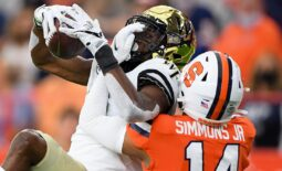 Oct 9, 2021; Syracuse, New York, USA; Wake Forest Demon Deacons wide receiver Jaquarii Roberson (5) catches the ball as Syracuse Orange defensive back Jason Simmons (14) defends during the first half at the Carrier Dome. Mandatory Credit: Rich Barnes-USA TODAY Sports