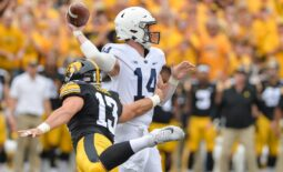 Oct 9, 2021; Iowa City, Iowa, USA; Penn State Nittany Lions quarterback Sean Clifford (14) throws a pass as Iowa Hawkeyes defensive end Joe Evans (13) rushes in during the first quarter at Kinnick Stadium. Mandatory Credit: Jeffrey Becker-USA TODAY Sports
