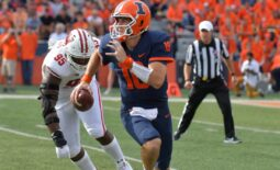 Oct 9, 2021; Champaign, Illinois, USA;  Illinois Fighting Illini quarterback Brandon Peters (18) runs with the ball as Wisconsin Badgers defensive tackle Keeanu Benton (95) pursues in the first half at Memorial Stadium. Mandatory Credit: Ron Johnson-USA TODAY Sports