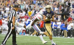 Oct 9, 2021; Annapolis, Maryland, USA;  Navy Midshipmen fullback Kai Puailoa-Rojas (21) catches a pass for a touch down as Southern Methodist Mustangs safety Isaiah Nwokobia (12) defends during the first half at Navy-Marine Corps Memorial Stadium. Mandatory Credit: Tommy Gilligan-USA TODAY Sports