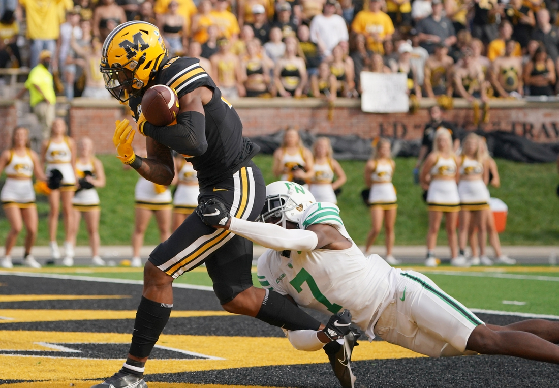 Oct 9, 2021; Columbia, Missouri, USA; Missouri Tigers wide receiver JJ Hester (13) scores as North Texas Mean Green defensive back Upton Stout (7) makes the tackle during the first half at Faurot Field at Memorial Stadium. Mandatory Credit: Denny Medley-USA TODAY Sports