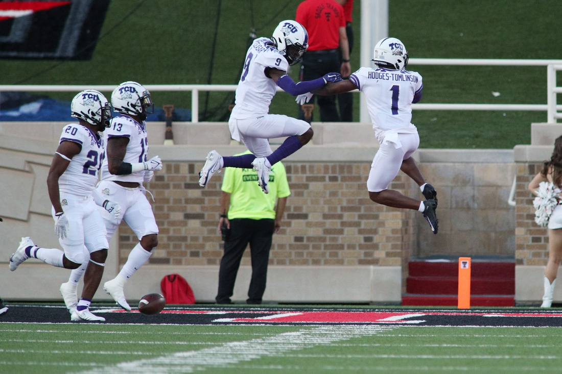 Oct 9, 2021; Lubbock, Texas, USA;  Texas Christian Horned Frogs defensive corner back Tre Vius Hodges-Thomlison (1) and defensive corner back C.J. Ceaser (9) react after scoring a touchdown against the Texas Tech Red Raiders in the first half at Jones AT&T Stadium. Mandatory Credit: Michael C. Johnson-USA TODAY Sports