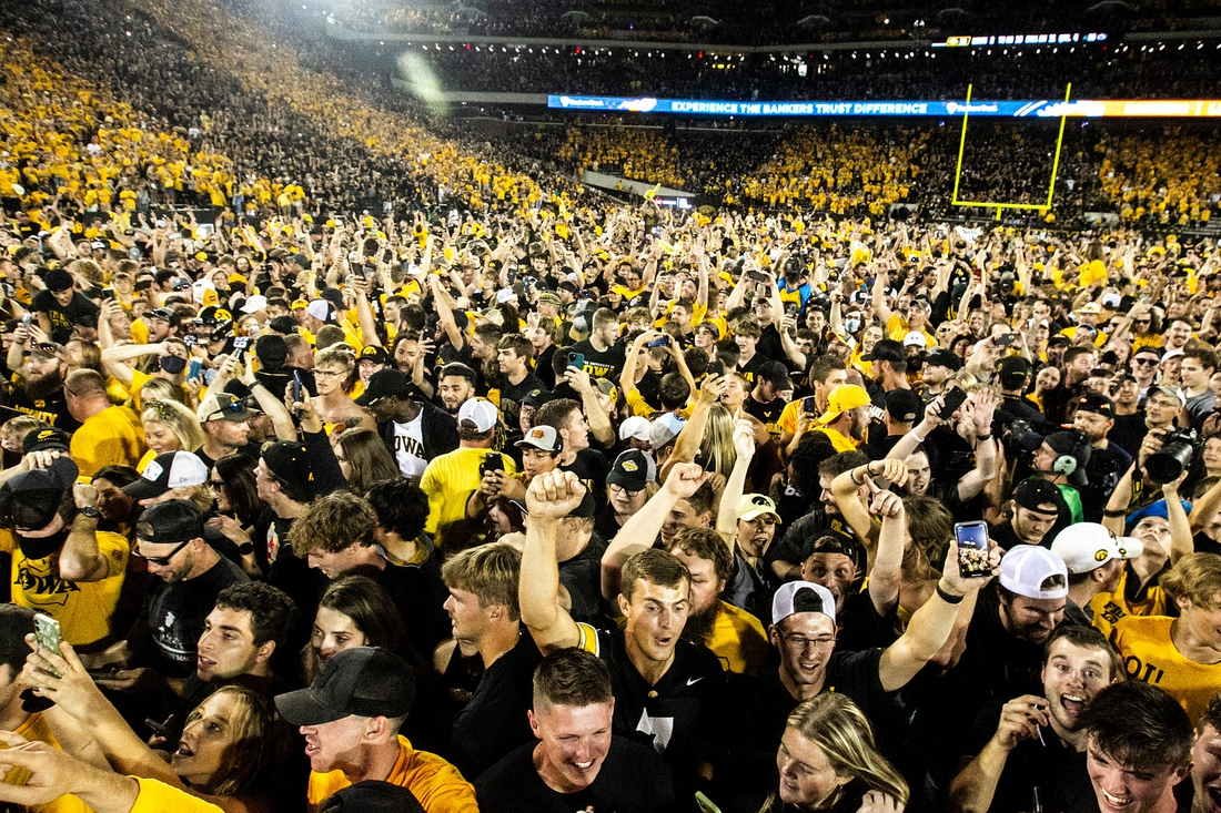 Iowa Hawkeyes fans celebrate while storming the field after a NCAA Big Ten Conference football game against Penn State, Saturday, Oct. 9, 2021, at Kinnick Stadium in Iowa City, Iowa. Iowa beat Penn State, 23-20.  211009 Penn St Iowa Fb 082 Jpg
