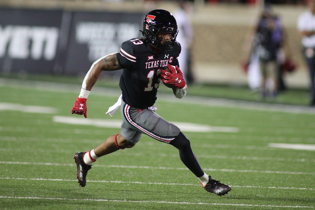 Oct 9, 2021; Lubbock, Texas, USA;  Texas Tech Red Raiders wide receiver Erik Ezukanma (13) rushes in the second half against the Texas Christian Horned Frogs at Jones AT&T Stadium. Mandatory Credit: Michael C. Johnson-USA TODAY Sports