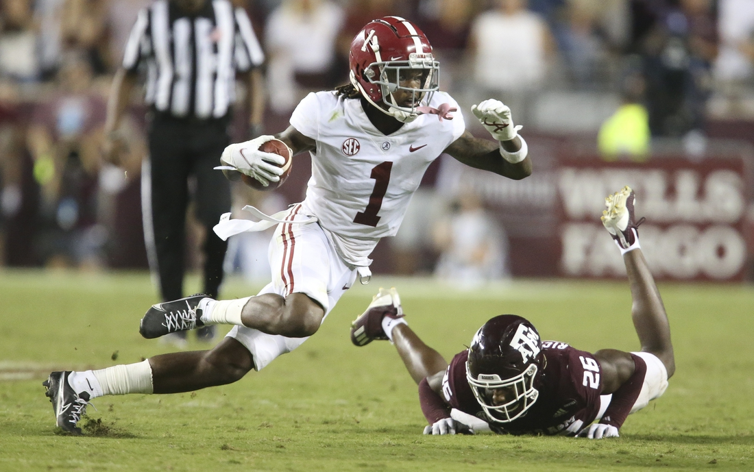 Oct 9, 2021; College Station, Texas, USA;  Alabama wide receiver Jameson Williams (1) makes a move on Texas A&M defensive back Demani Richardson (26) at Kyle Field. Texas A&M defeated Alabama 41-38 on a field goal as time expired. Mandatory Credit: Gary Cosby Jr.-USA TODAY Sports