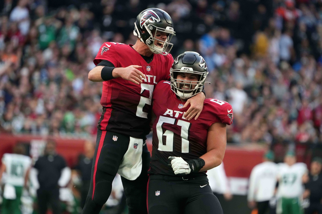Oct 10, 2021; London, England, United Kingdom; Atlanta Falcons quarterback Matt Ryan (2) and center Matt Hennessy (61) celebrate after a touchdown in the fourth quarter against the New York Jets during an NFL International Series aame at Tottenham Hotspur Stadium. The Falcons defeated the Jets 27-20. Mandatory Credit: Kirby Lee-USA TODAY Sports