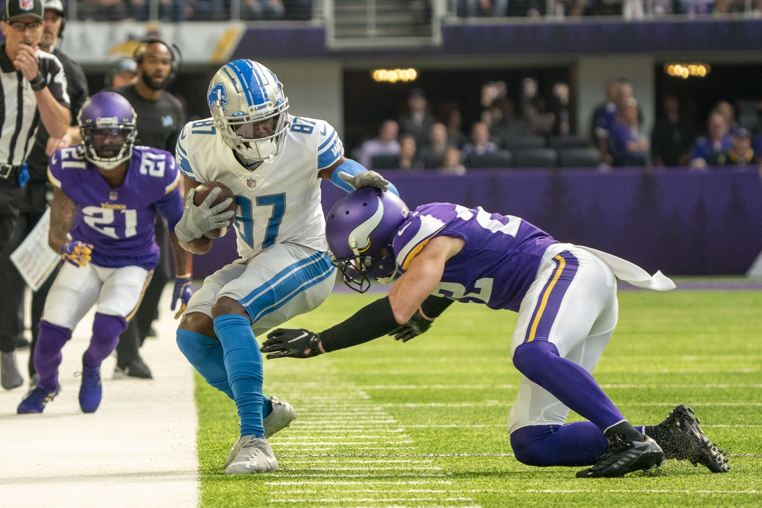 Oct 10, 2021; Minneapolis, Minnesota, USA; Detroit Lions wide receiver Quintez Cephus (87) is pushed out of bounds by Minnesota Vikings safety Harrison Smith (22) in the first quarter at U.S. Bank Stadium. Mandatory Credit: Matt Blewett-USA TODAY Sports