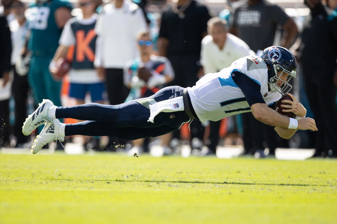 Oct 10, 2021; Jacksonville, Florida, USA; Tennessee Titans quarterback Ryan Tannehill (17) dives for the first down during the second half against the Jacksonville Jaguars at TIAA Bank Field. Mandatory Credit: Matt Pendleton-USA TODAY Sports