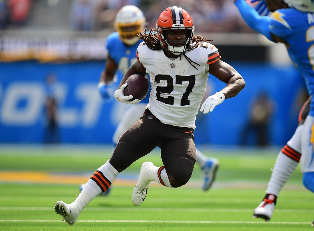 Oct 10, 2021; Inglewood, California, USA; Cleveland Browns running back Kareem Hunt (27) runs the ball against the Los Angeles Chargers during the first half at SoFi Stadium. Mandatory Credit: Gary A. Vasquez-USA TODAY Sports