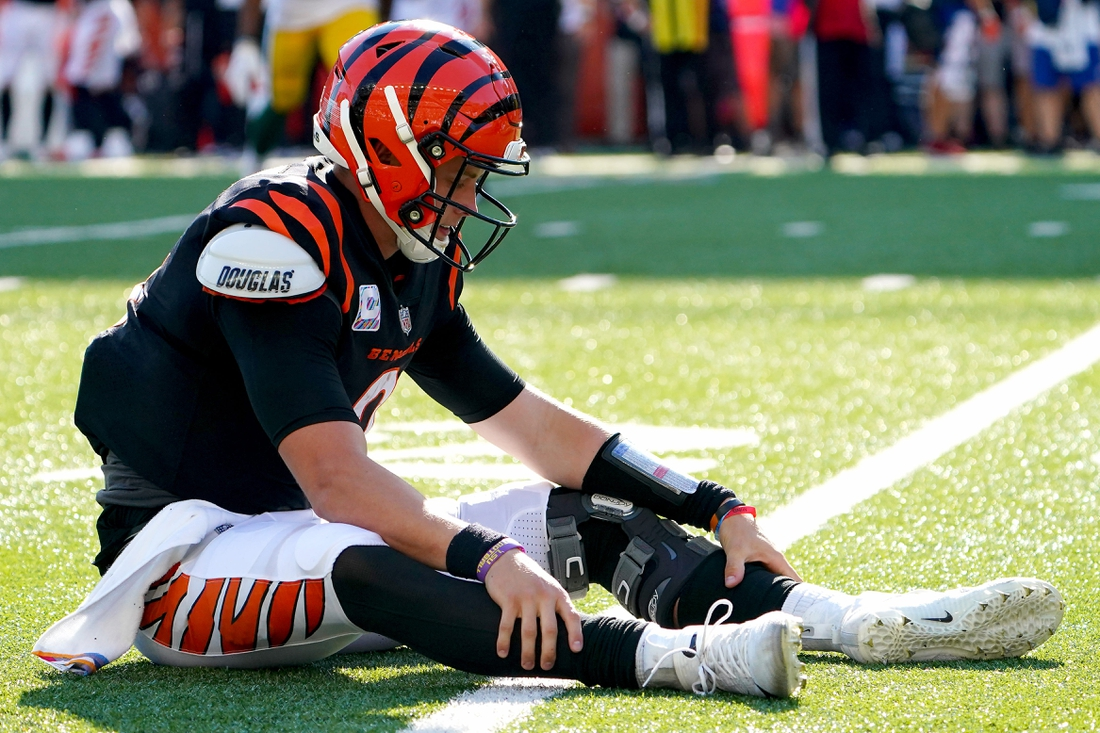 Cincinnati Bengals quarterback Joe Burrow (9) reacts after throwing an interception in overtime of a Week 5 NFL football game against the Green Bay Packers, Sunday, Oct. 10, 2021, at Paul Brown Stadium in Cincinnati. The Green Bay Packers won, 25-22.  Green Bay Packers At Cincinnati Bengals Oct 10