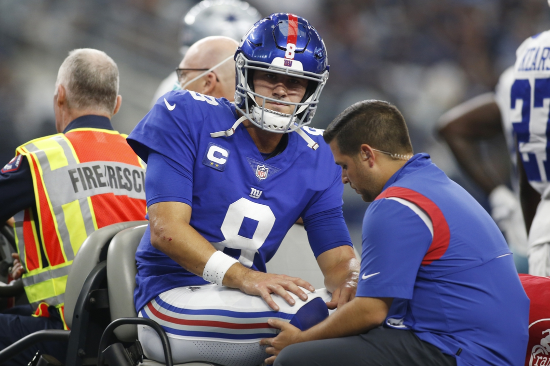 Oct 10, 2021; Arlington, Texas, USA; New York Giants quarterback Daniel Jones (8) leaves the field on a cart with an injury in the second quarter against the Dallas Cowboys at AT&T Stadium. Mandatory Credit: Tim Heitman-USA TODAY Sports
