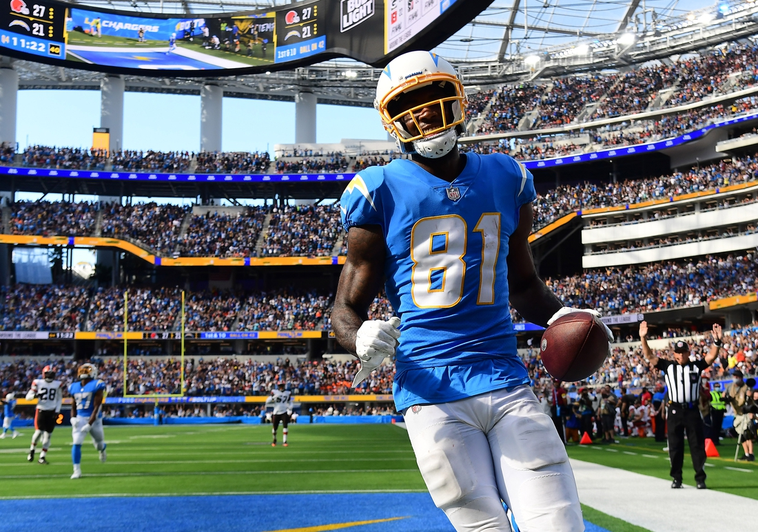 Oct 10, 2021; Inglewood, California, USA; Los Angeles Chargers wide receiver Mike Williams (81) scores a touchdown against the Cleveland Browns during the second half at SoFi Stadium. Mandatory Credit: Gary A. Vasquez-USA TODAY Sports