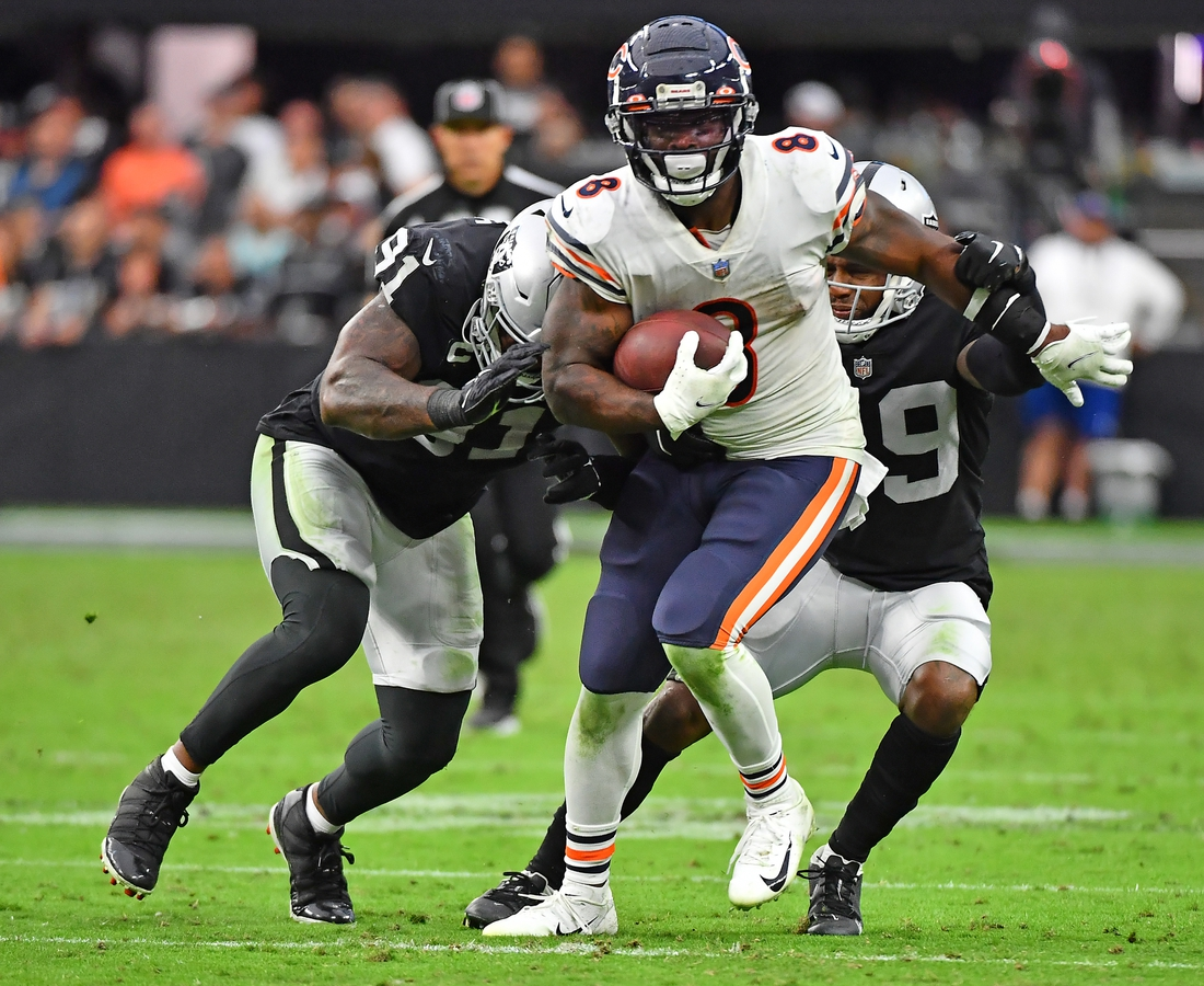 Oct 10, 2021; Paradise, Nevada, USA; Chicago Bears running back Damien Williams (8) spins out of the reach of Las Vegas Raiders defensive end Yannick Ngakoue (91) and Las Vegas Raiders cornerback Casey Hayward (29) during a game at Allegiant Stadium. Mandatory Credit: Stephen R. Sylvanie-USA TODAY Sports