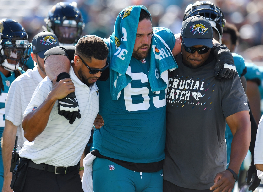 Jacksonville Jaguars center Brandon Linder (65) is assisted to a cart after he was injured during a fourth quarter play. The Jacksonville Jaguars hosted the Tennessee Titans at TIAA Bank Field in Jacksonville, Florida, October 10, 2021.  The Jaguars trailed at the half 24 to 13 and lost with a final score of 37-19. [Bob Self/Florida Times-Union]  Jki 101021 Jaguarsvstitans 35