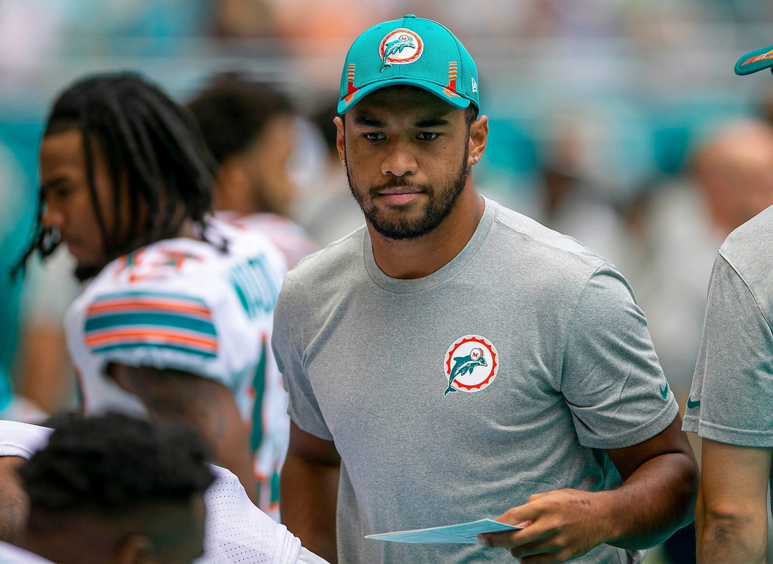 Miami Dolphins Miami Dolphins quarterback Tua Tagovailoa (1) greets teammates before the start of the game against Indianapolis Colts during NFL game at Hard Rock Stadium Sunday in Miami Gardens.  Syndication Palm Beach Post