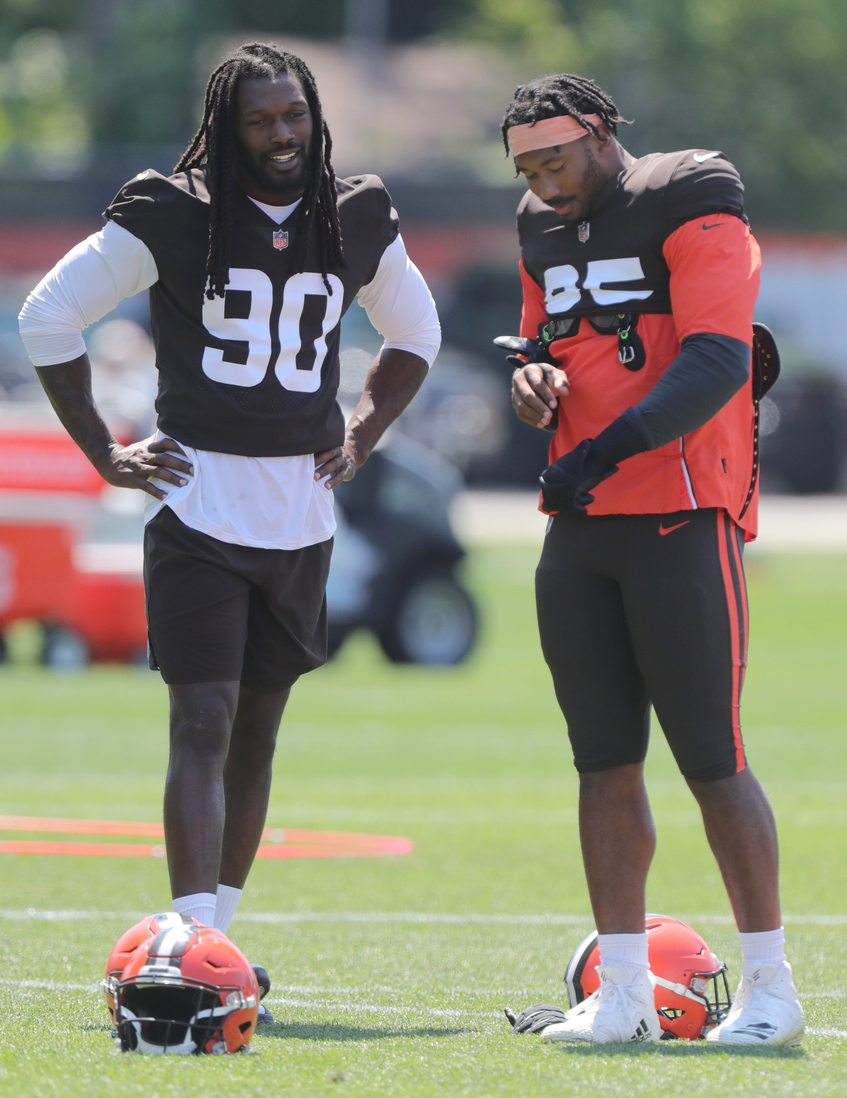 Browns defensive ends Jadeveon Clowney and Myles Garrett get ready for the start of practice on Wednesday, August 4, 2021 in Berea, Ohio, at CrossCountry Mortgage Campus. [Phil Masturzo/ Beacon Journal]  Browns 8 5 5