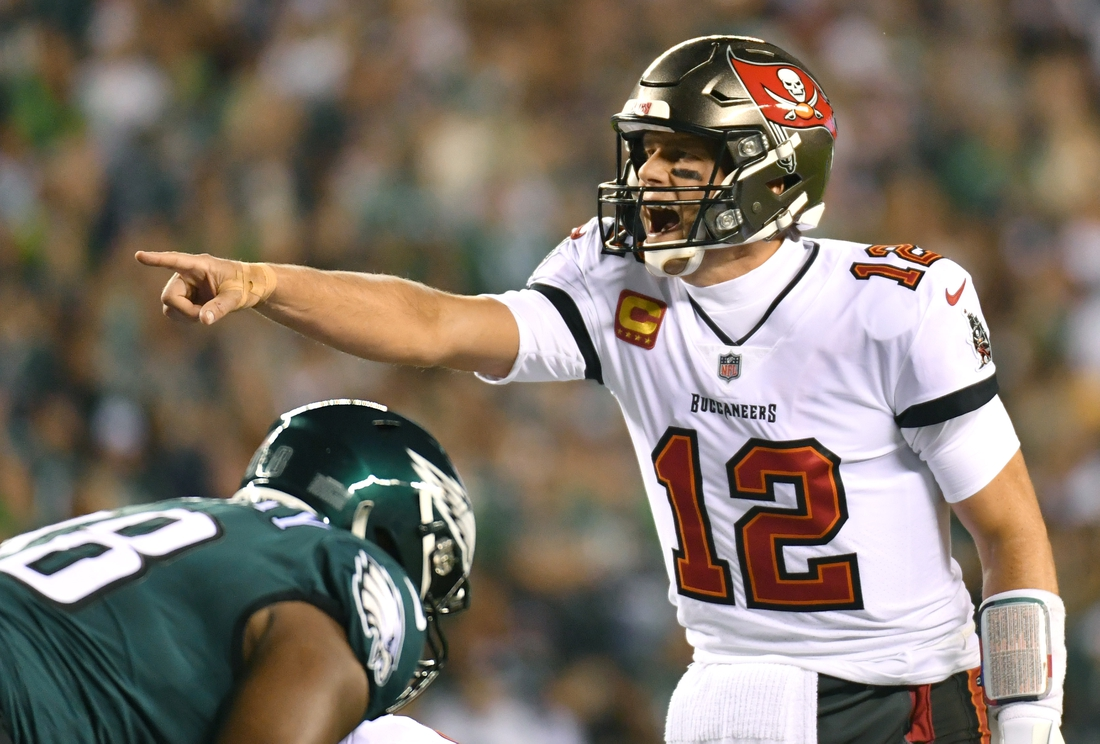 Oct 14, 2021; Philadelphia, Pennsylvania, USA; Tampa Bay Buccaneers quarterback Tom Brady (12) calls a play against the Philadelphia Eagles during the first quarter at Lincoln Financial Field. Mandatory Credit: Eric Hartline-USA TODAY Sports