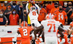 Oct 15, 2021; Syracuse, New York, USA; Clemson Tigers wide receiver Justyn Ross (8) catches the ball in front of Syracuse Orange linebacker Marlowe Wax (2) during the first half at the Carrier Dome. Mandatory Credit: Rich Barnes-USA TODAY Sports
