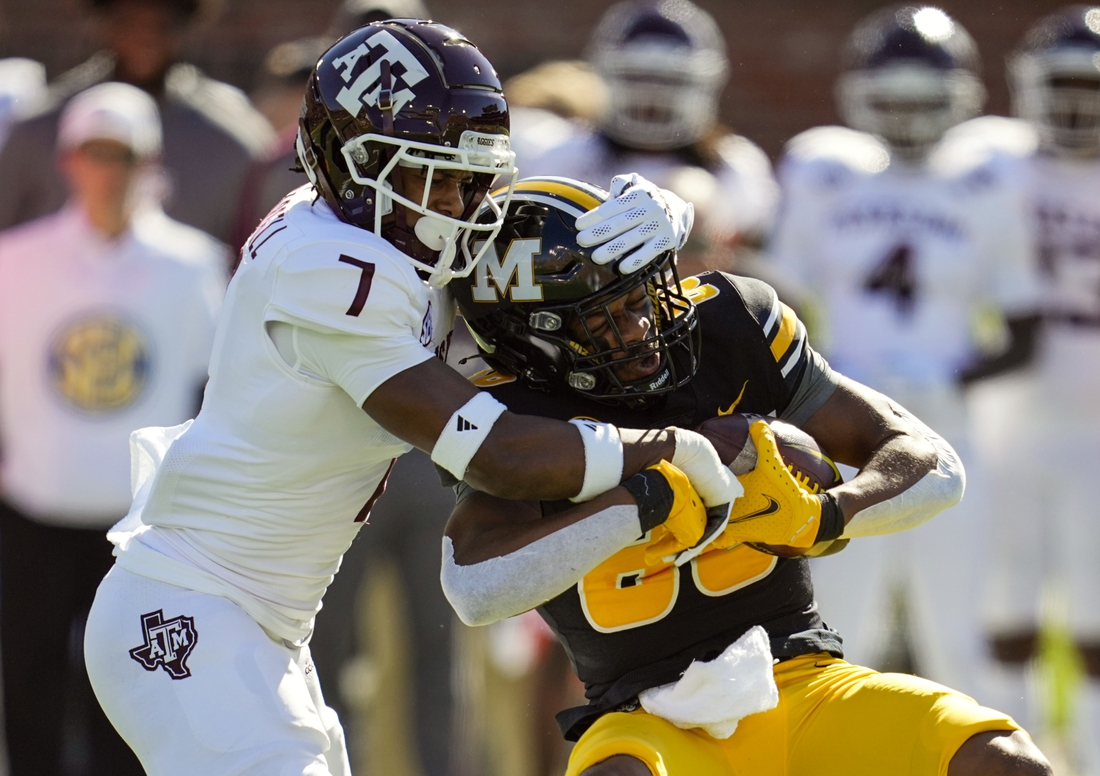Oct 16, 2021; Columbia, Missouri, USA; Missouri Tigers wide receiver Tauskie Dove (86) is tackled by Texas A&M Aggies defensive back Tyreek Chappell (7) during the first half at Faurot Field at Memorial Stadium. Mandatory Credit: Jay Biggerstaff-USA TODAY Sports