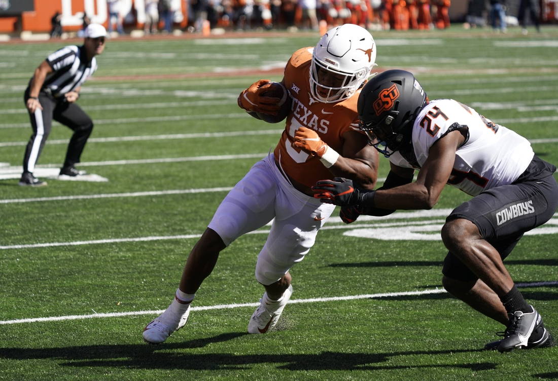 Oct 16, 2021; Austin, Texas, USA; Texas Longhorns running back Bijan Robinson (5) runs for yardage in the red zone in the first half of the game against the Oklahoma State Cowboys at Darrell K Royal-Texas Memorial Stadium. Mandatory Credit: Scott Wachter-USA TODAY Sports