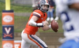 Oct 16, 2021; Charlottesville, Virginia, USA; Virginia Cavaliers quarterback Brennan Armstrong (5) scrambles with the ball against the Duke Blue Devils during the third quarter at Scott Stadium. Mandatory Credit: Geoff Burke-USA TODAY Sports