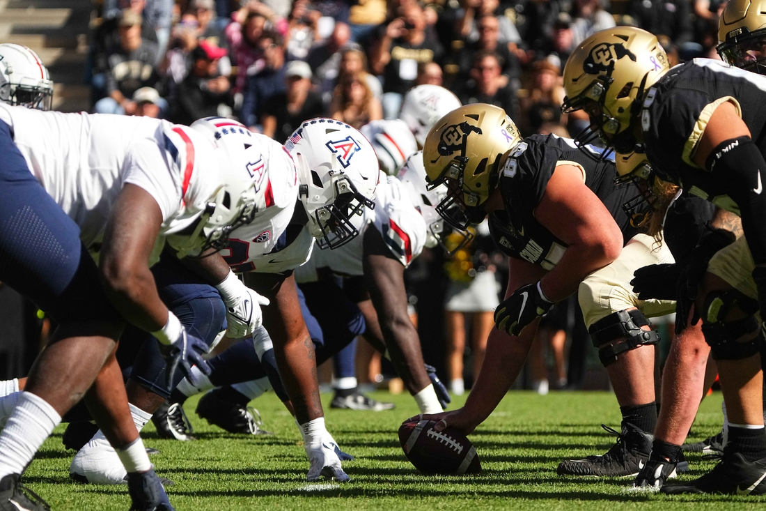 Oct 16, 2021; Boulder, Colorado, USA; Members of the Arizona Wildcats line up across from the Colorado Buffaloes in the first quarter at Folsom Field. Mandatory Credit: Ron Chenoy-USA TODAY Sports