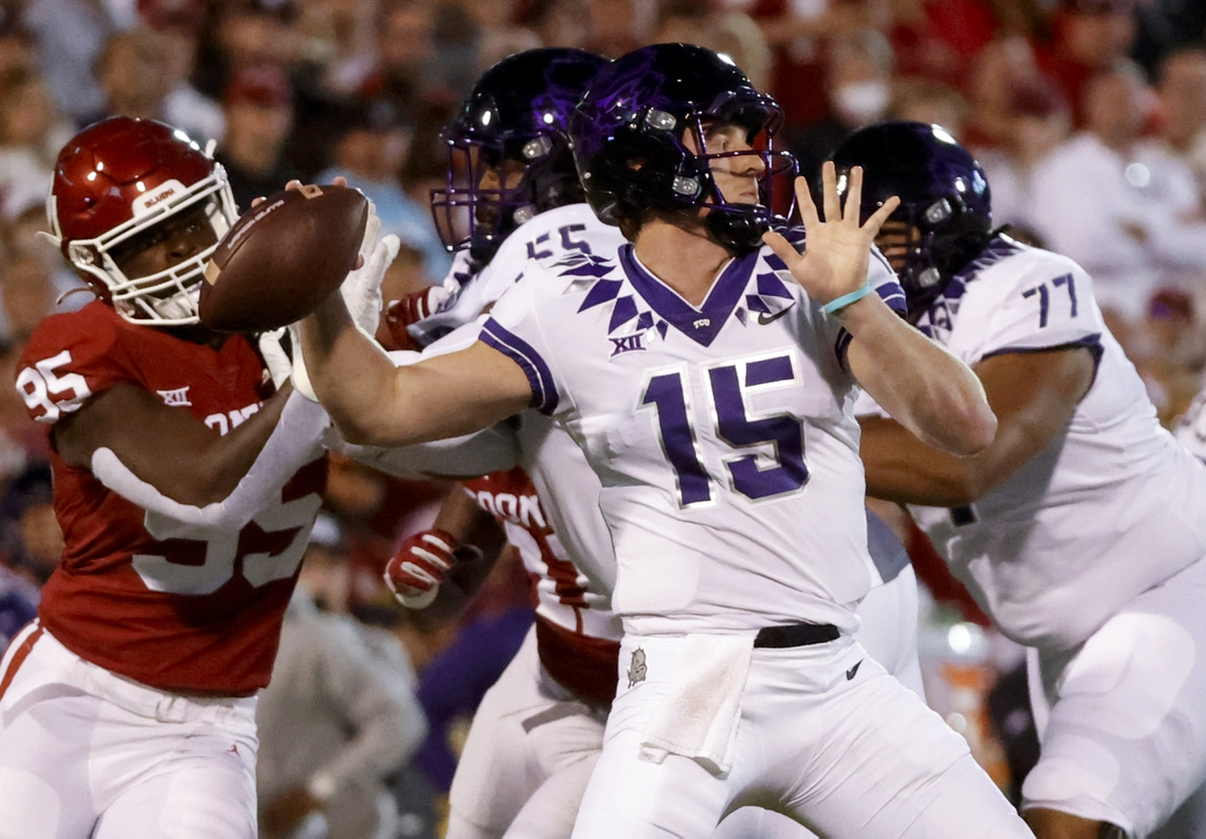 Oct 16, 2021; Norman, Oklahoma, USA; TCU Horned Frogs quarterback Max Duggan (15) throws during the first quarter against the Oklahoma Sooners at Gaylord Family-Oklahoma Memorial Stadium. Mandatory Credit: Kevin Jairaj-USA TODAY Sports