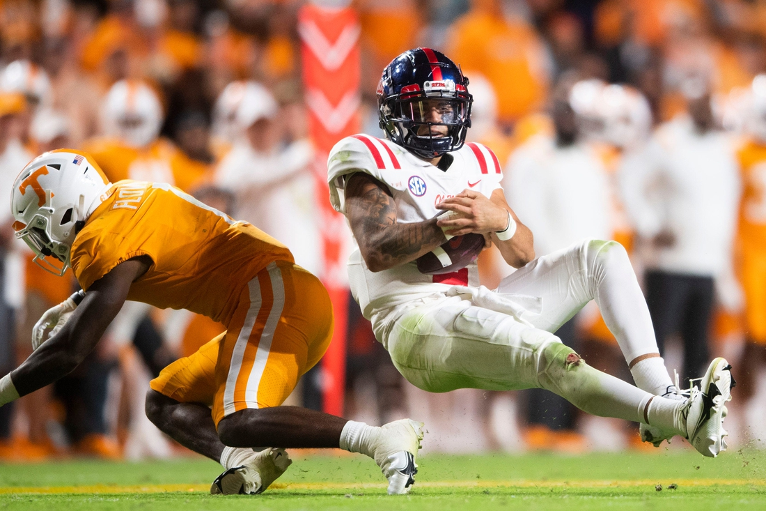 Mississippi quarterback Matt Corral (2) is knocked over by Tennessee defensive back Trevon Flowers (1) during an SEC football game between Tennessee and Ole Miss at Neyland Stadium in Knoxville, Tenn. on Saturday, Oct. 16, 2021.  Kns Tennessee Ole Miss Football