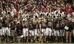 Oct 16, 2021; Salt Lake City, Utah, USA;  Utah Utes players raise their helmets and cheer during the fourth quarter break in a tribute to Aaron Lowe and Ty Jordan in a game against the Arizona State Sun Devils at Rice-Eccles Stadium. Mandatory Credit: Rob Gray-USA TODAY Sports