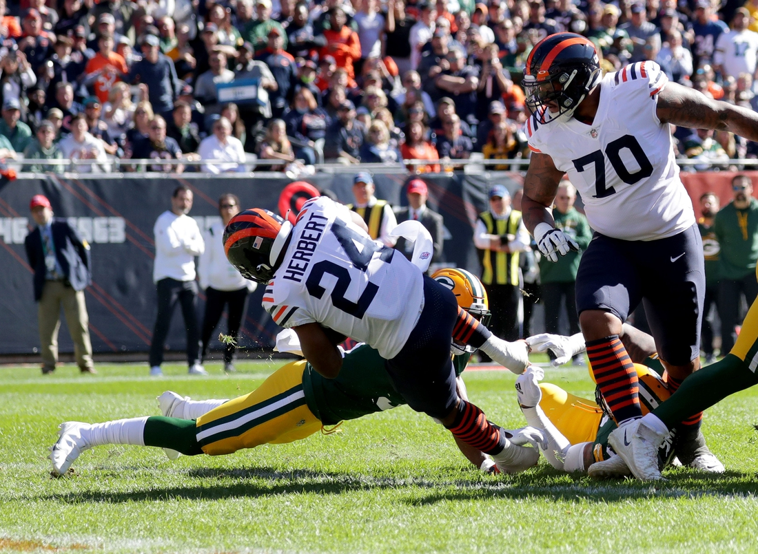 Oct 17, 2021; Chicago, IL, USA;  Chicago Bears running back Khalil Herbert (24) scores a touchdown during the first quarter of their game against the Green Bay Packers at Soldier Field in Chicago on Sunday, Oct. 17, 2021. Mandatory Credit: Mike De Sisti-USA TODAY Sports