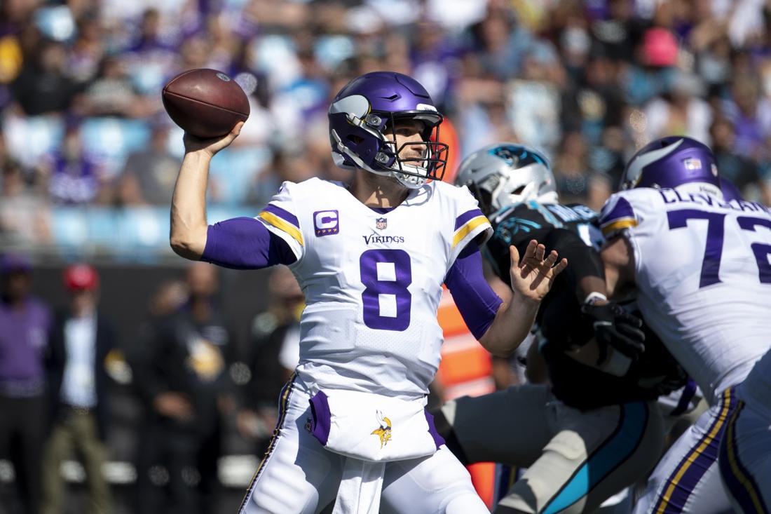 Oct 17, 2021; Charlotte, North Carolina, USA;  Minnesota Vikings quarterback Kirk Cousins (8) looks to pass in the second quarter at Bank of America Stadium. Mandatory Credit: Bob Donnan-USA TODAY Sports