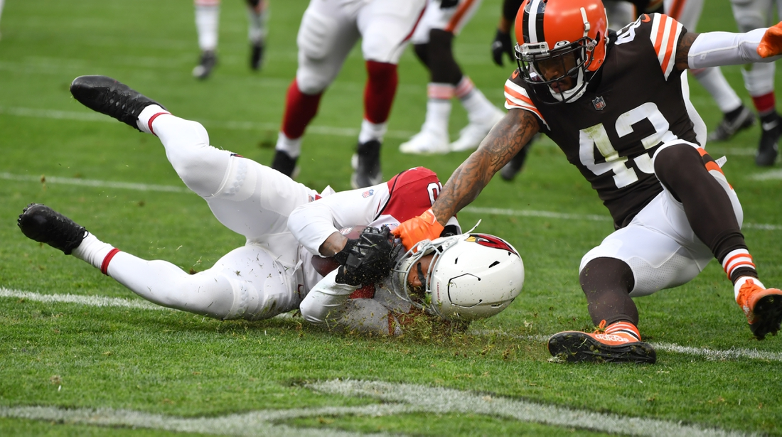 Oct 17, 2021; Cleveland, Ohio, USA; Arizona Cardinals wide receiver DeAndre Hopkins (10) catches a touchdown pass as Cleveland Browns free safety John Johnson (43) defends during the first half at FirstEnergy Stadium. Mandatory Credit: Ken Blaze-USA TODAY Sports