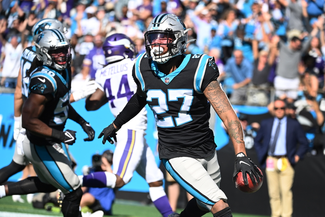 Oct 17, 2021; Charlotte, North Carolina, USA; Carolina Panthers safety Kenny Robinson (27) picks up a block punt and returns it for a toudhdown in the third quarter at Bank of America Stadium. Mandatory Credit: Bob Donnan-USA TODAY Sports