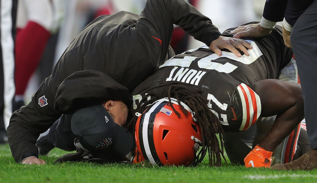 Cleveland Browns running back Kareem Hunt (27) is met by staff members after sustaining an injury during the second half of an NFL football game at FirstEnergy Stadium, Sunday, Oct. 17, 2021, in Cleveland, Ohio. [Jeff Lange/Beacon Journal]  Browns 7